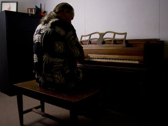The dean on his office piano