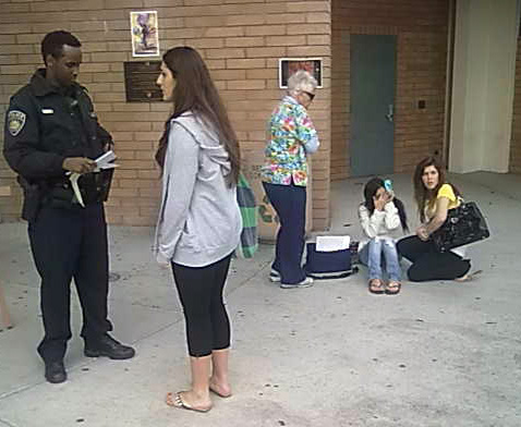 (from left) Officer Bashir Abdi receives info from Tanya Barho, while Health Services nurse Anne Taylor comforts the victim who is accompanied by a friend